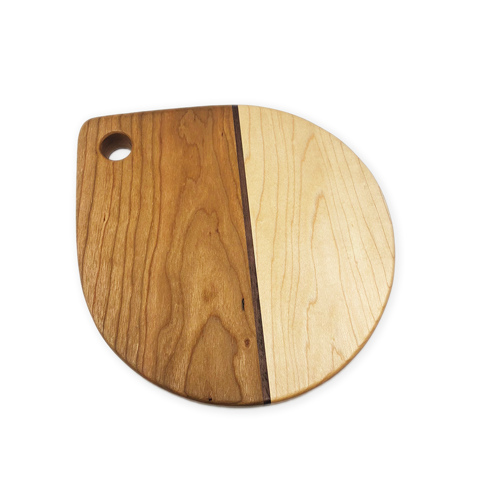 "Image of ""Raindrop"" cherry, maple, and walnut board"