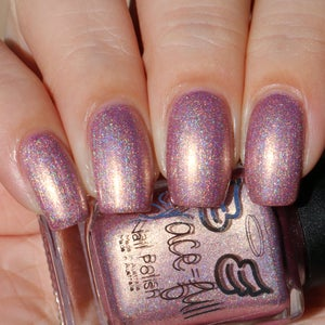 Image of Lula - dusty pink linear holo with brown undertones and a strong gold shift.