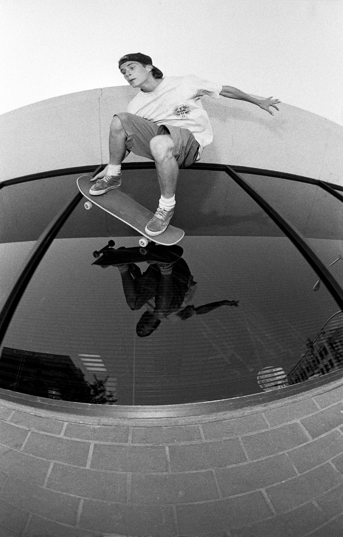 Image of John Cardiel, Glass ride, Bakersfield CA 1992, Spitfire Wheels ad, by Tobin Yelland
