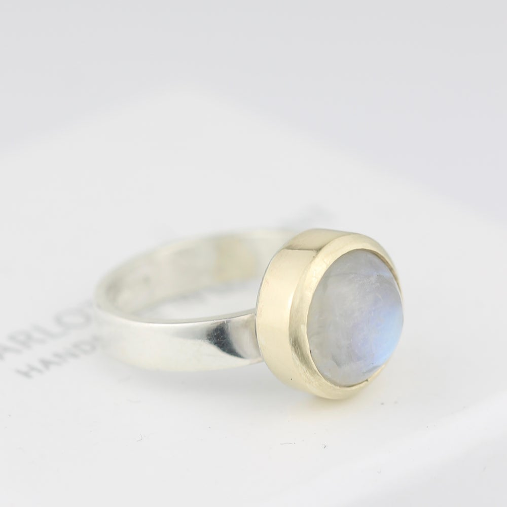 Image of MOONSTONE RING IN SILVER WITH A GOLD SETTING