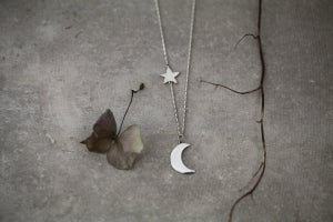 Image of crescent moon and star necklace in silver and 9ct gold