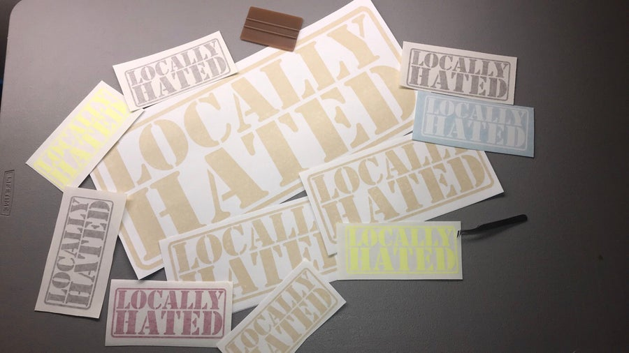 Image of 12x5 badge decal