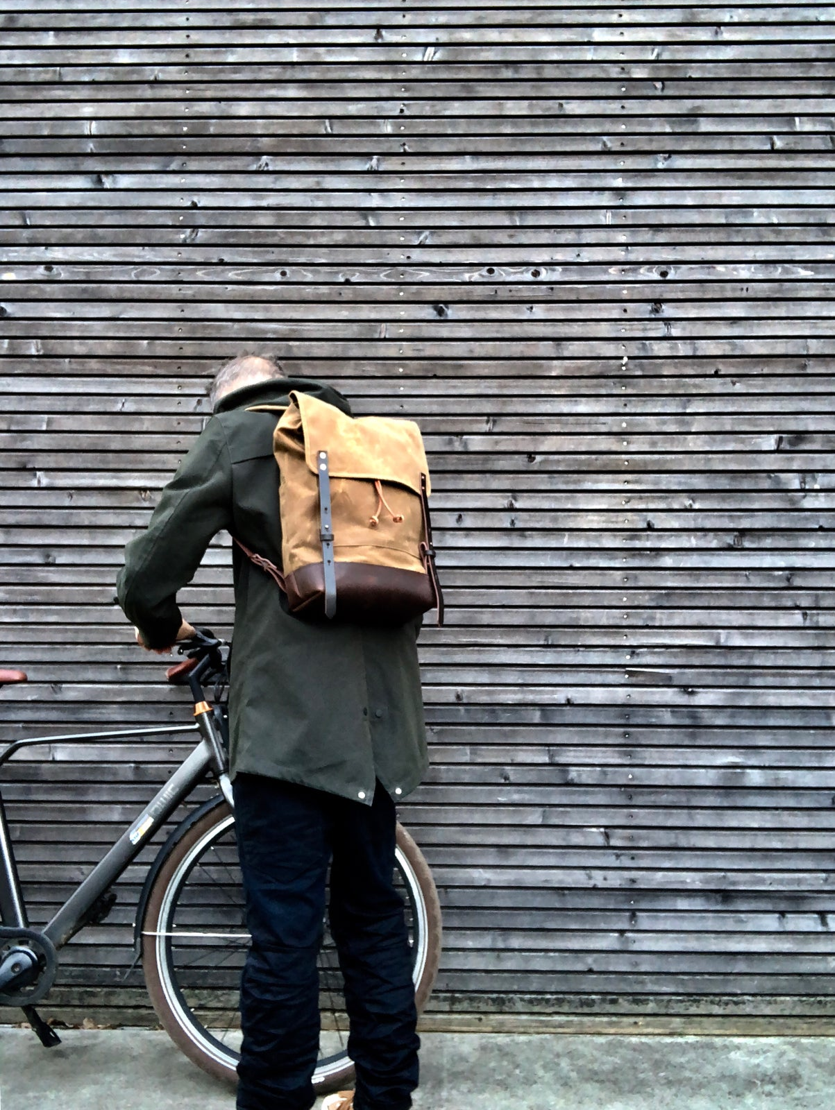 Image of Waxed canvas backpack / rucksack with folded top and waxed canvas flap