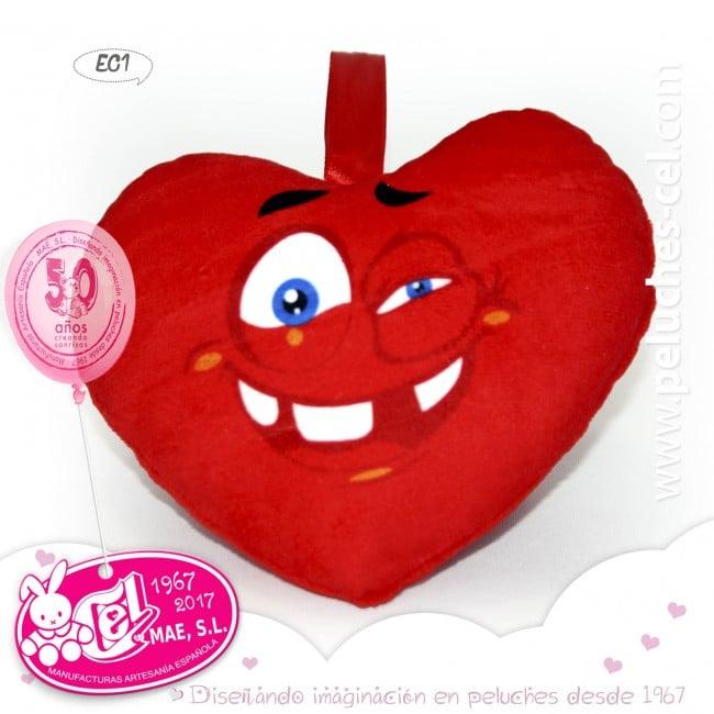 Image of Corazon rojo de peluche de 32 centimetros de altura con una carita sonriente y ojos semiabiertos