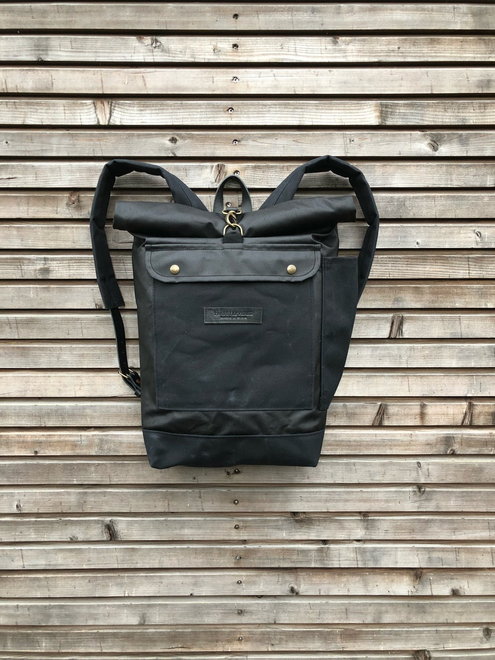 Image of Waxed canvas backpack with roll up top and double waxed bottem COLLECTION UNISEX