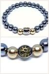 "'PotLuck"" 8mm hematite stretch bracelet with 10k gold beads"