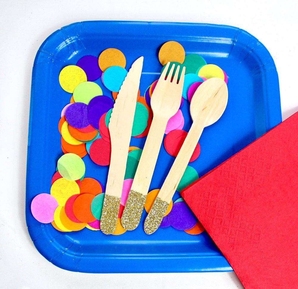 Image of Plates napkins and cutlery
