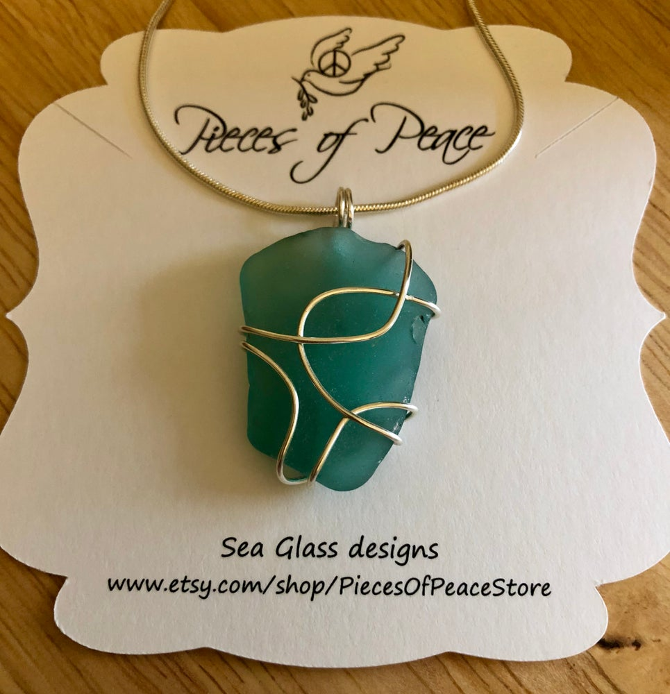 Image of Abstract teal Caribbean Sea glass pendant