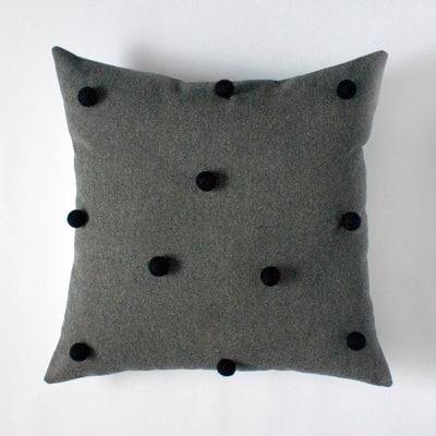 Image of charcoal & black pom pom cushion cover