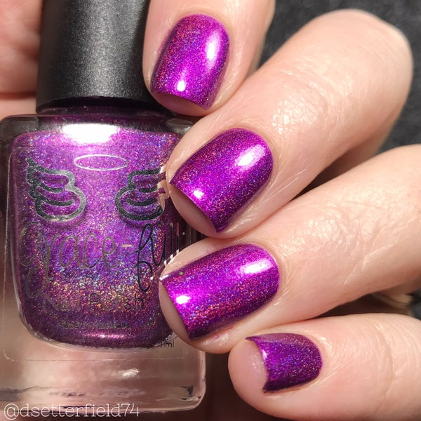 Image of Zooper Dooper – a bright violet purple linear holo