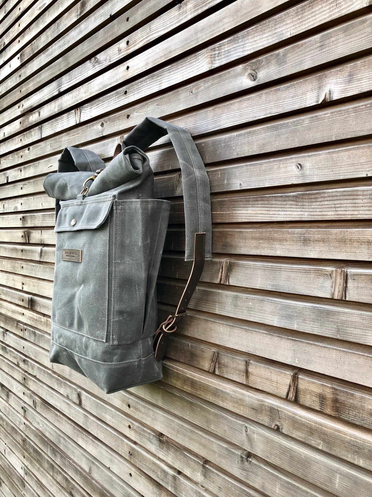 Image of Waxed canvas rucksack in charcoal grey with roll up top and double waxed bottem