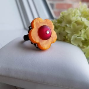 Image of Peace Love & Flowers – Orange Ruby