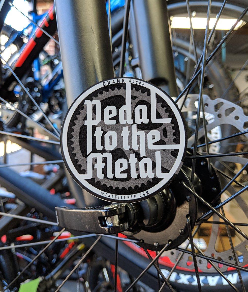 'Pedal to the Metal' matte finish round vinyl sticker.