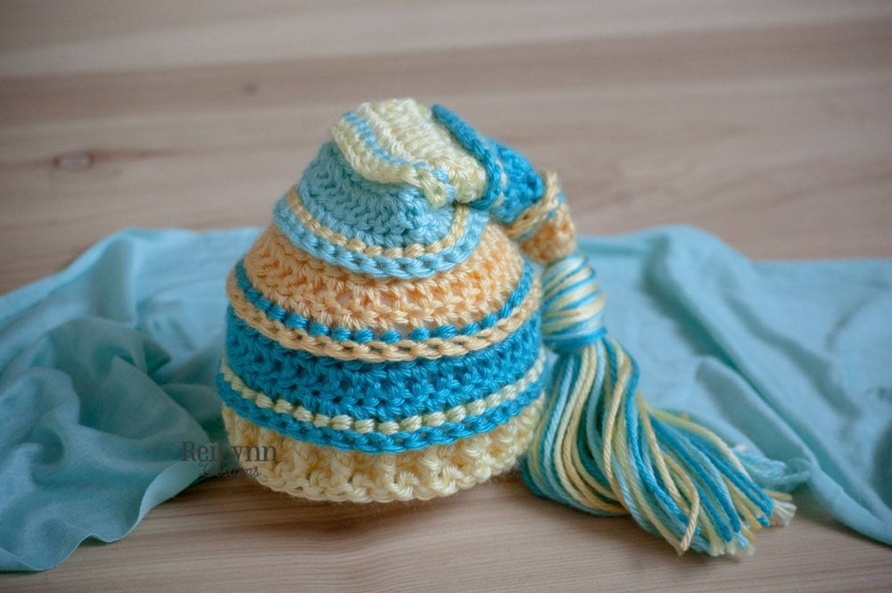 Image of Yellow, Turquoise, Baby Maize, and Aqua Newborn Tassel Hat