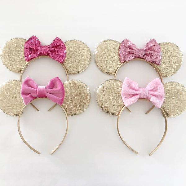 Image of Gold sequin ears with bright pink bows