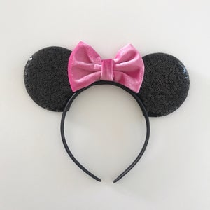 Image of Black sequin ears with bright pink bows