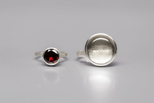 Image of silver rings with rock crystal and garnet MOTUS AMORE