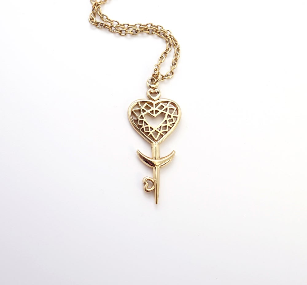 Image of Heart Space Key Pendant in Brass
