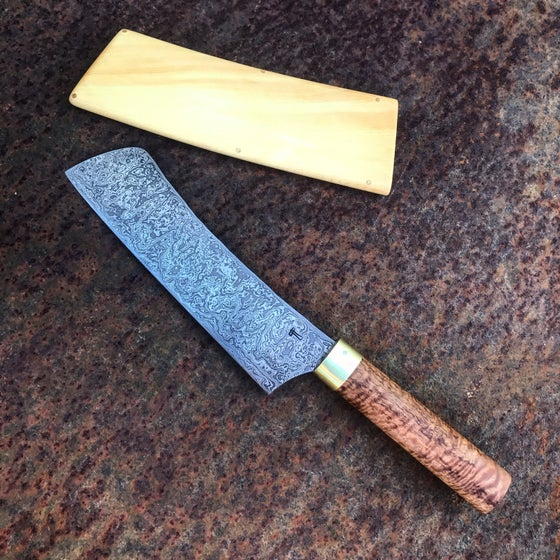 Image of Damascus steel multicultural knife