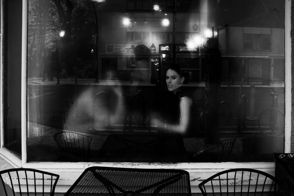 Image of Girl in Cafe Window