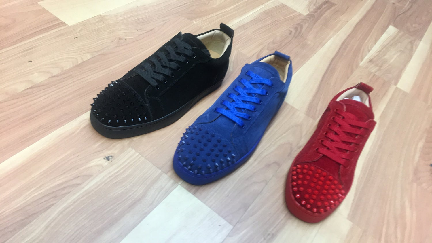 half off 10bf7 24ecd Christian Louboutin Spiked Sneakers