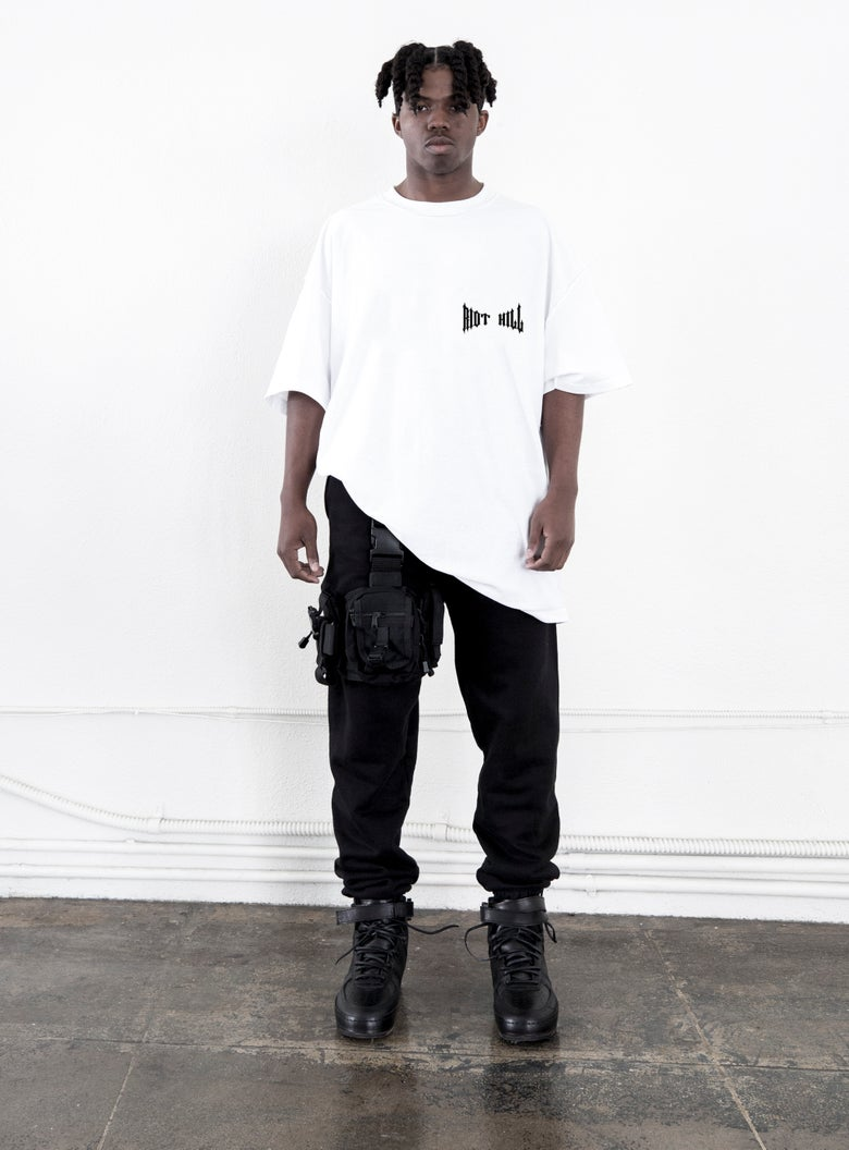 "Image of White ""RIOT  HILL"" Logo T-shirt"