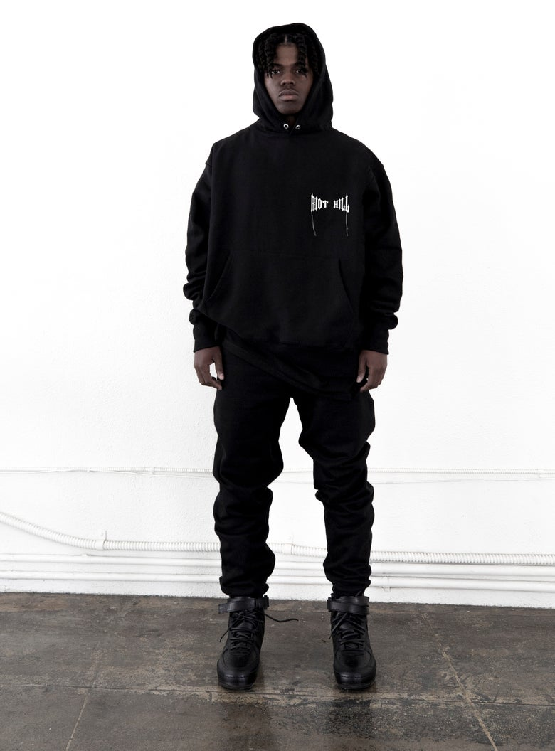"Image of Black ""RIOT  HILL"" Logo Hooded Sweatshirt"