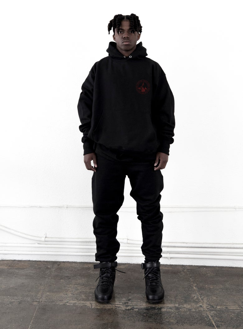 "Image of Black ""RHYDC"" Logo Hooded Sweatshirt"