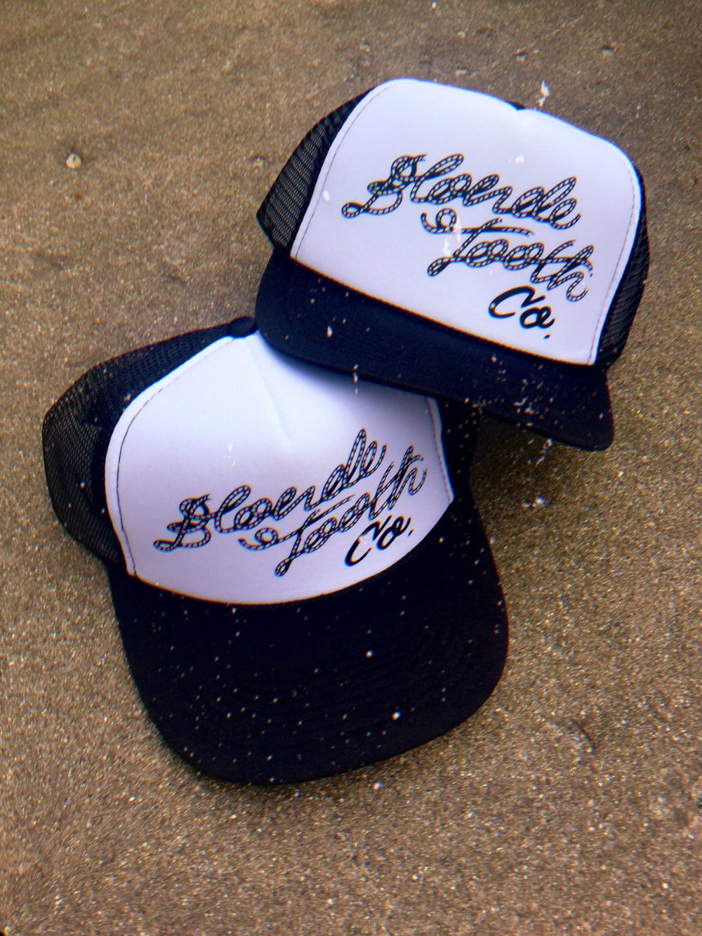 """Image of """"Blonde Tooth"""" logo trucker hat"""