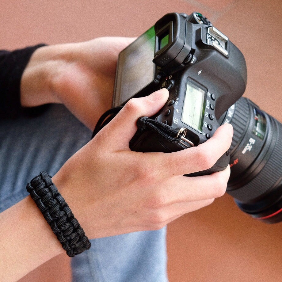 Image of Black camera wrist strap