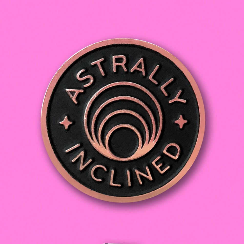 """Image of """"ASTRALLY INCLINED"""" ENAMEL PIN."""
