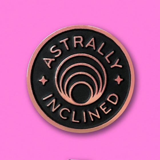 "Image of ""ASTRALLY INCLINED"" ENAMEL PIN."