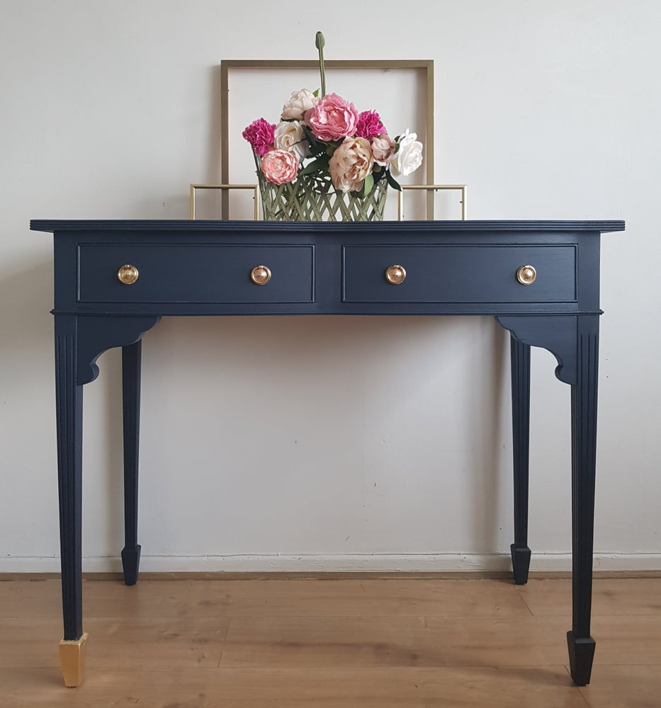 Image of Beautiful navy and gold console table