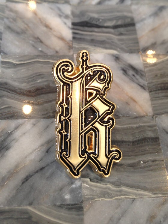 "Image of Gold Kapala ""K"" Pin"