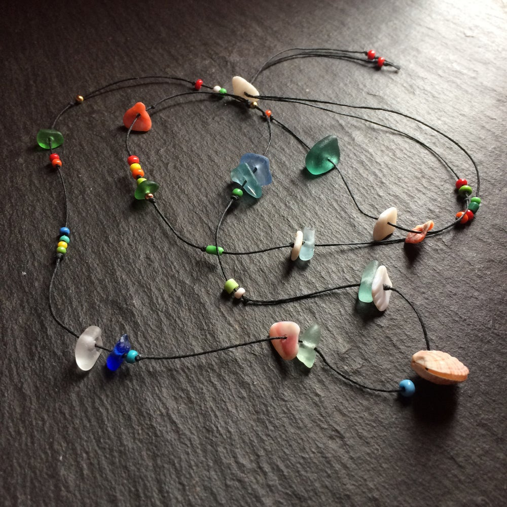 Image of Multiple beach find necklaces