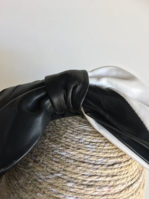 Image of Black and white leather bow