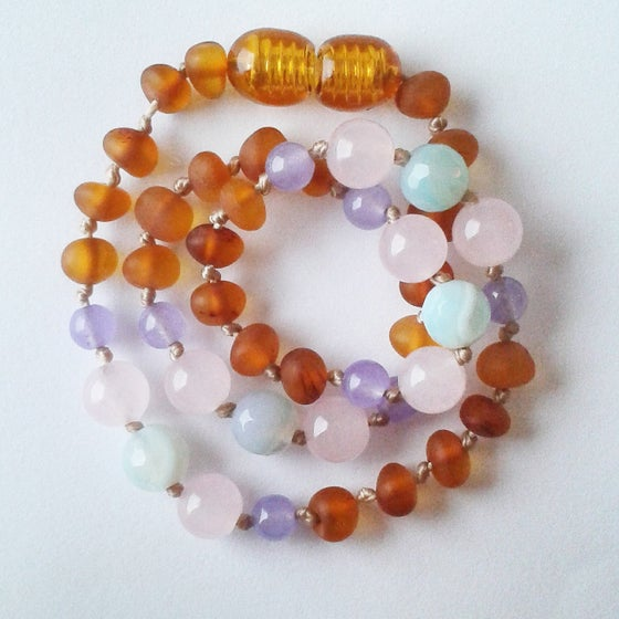 Image of Raw cognac Baltic amber with rose quartz, lilac jade and blue lace agate