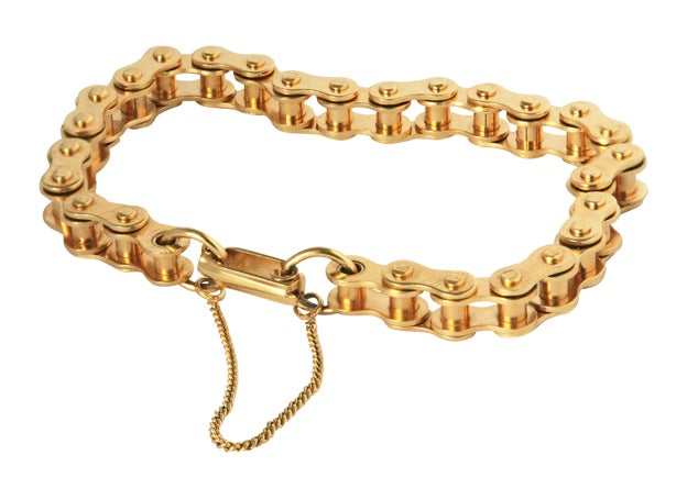 ICONIC GOLD PLATED BIKE CHAIN BRACELET  Roller chain bracelet made of 18k gold plated first quality stainless steel, with fold clasp. Although it looks like a bicycle chain, the scale of the chain is slightly smaller for a more delicate feel. The tiny chain added to the lock is a safety chain for security.  The classic, clean, cool and graceful bracelet is available in different sizes (see below)