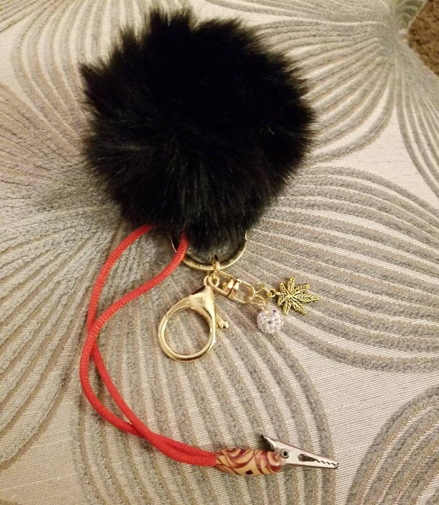 Image of ROACH CLIP pompom w pot leaf charm and sparkly bead