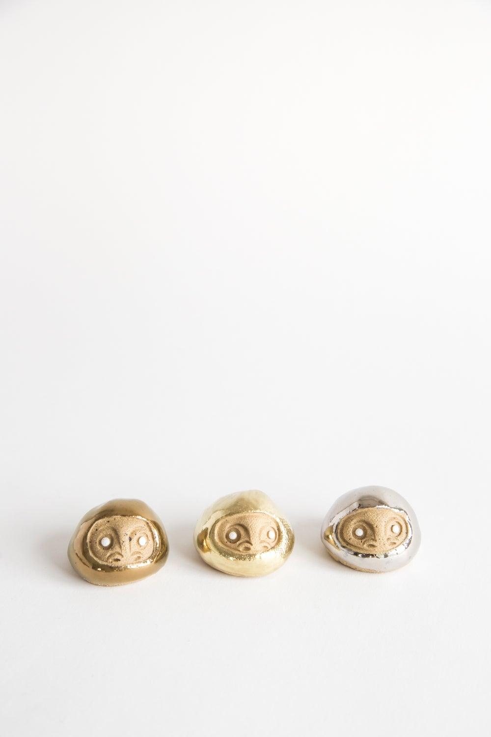 Image of Tiny Golden Daruma Wishing Dolls