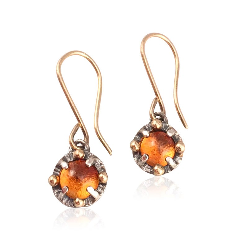 Image of juju citrine earrings in 18k gold and oxidized silver