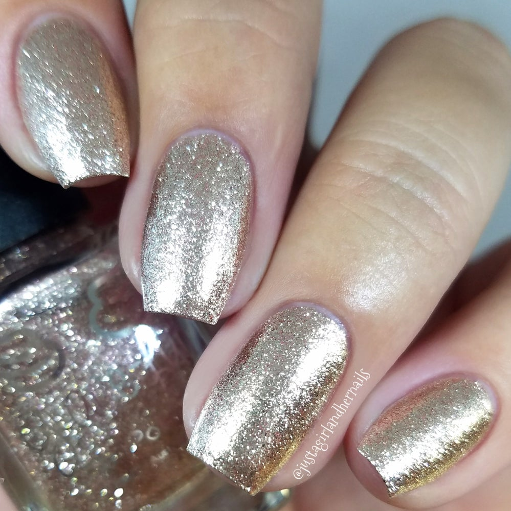 Image of Moonface – a champagne coloured metallic flakie polish