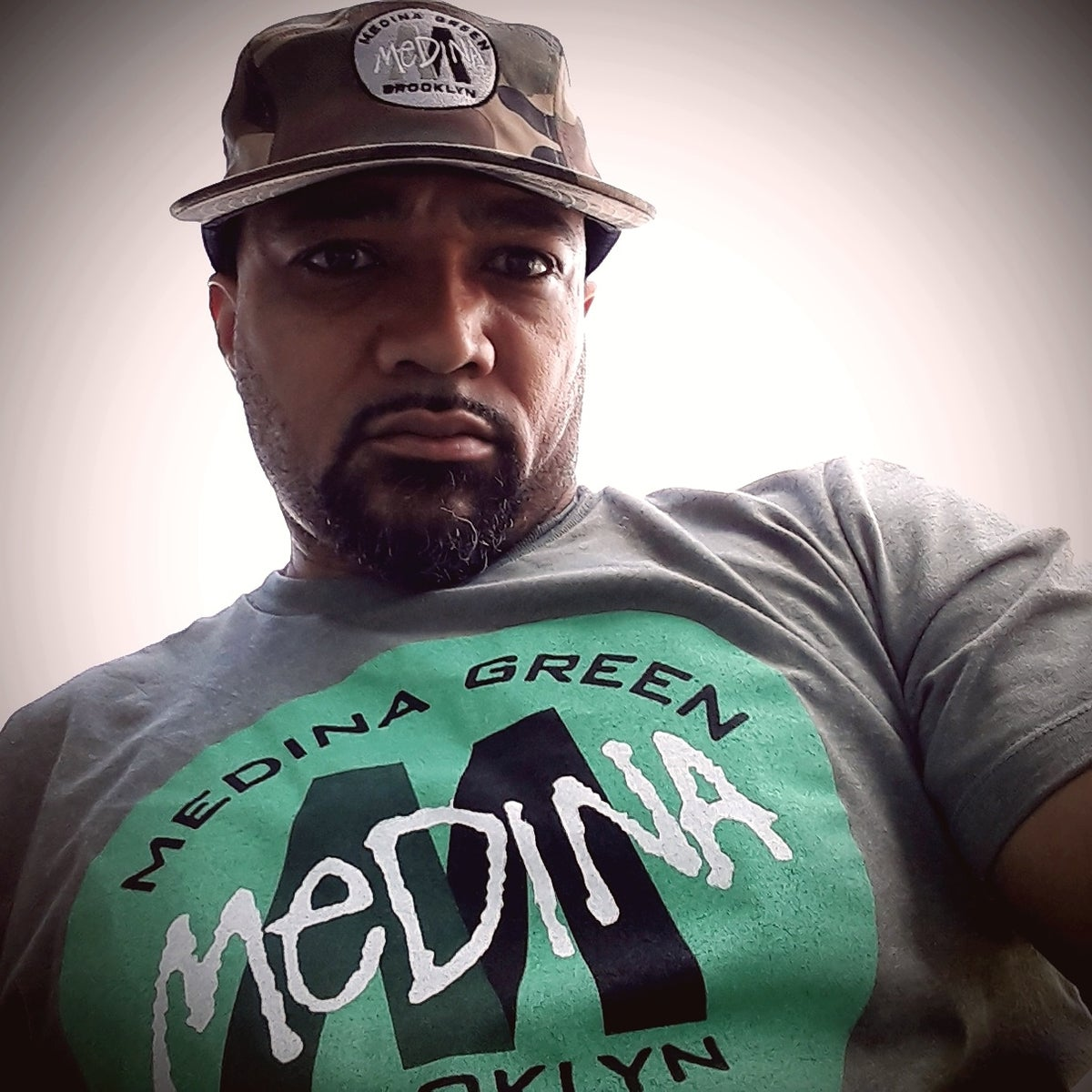 Image of Medina Green Core logo tee