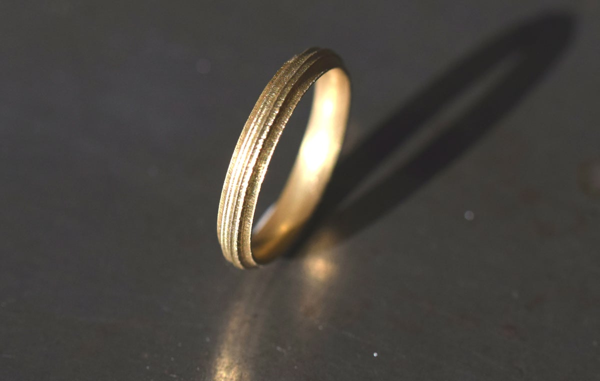 18ct Round, grooved 'Strata' Ring by Chris Boland. Wedding Band