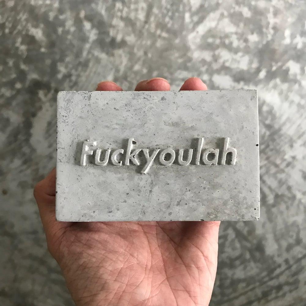 Image of Fuckyoulah concrete block