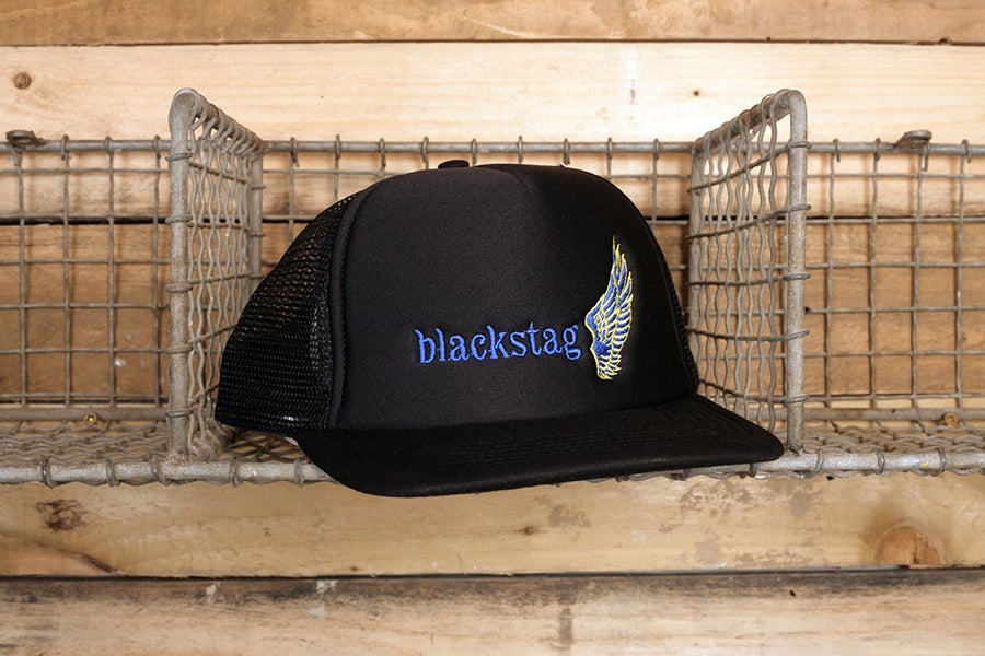 Image of Black meshback trucker. Purple and gold embroidery