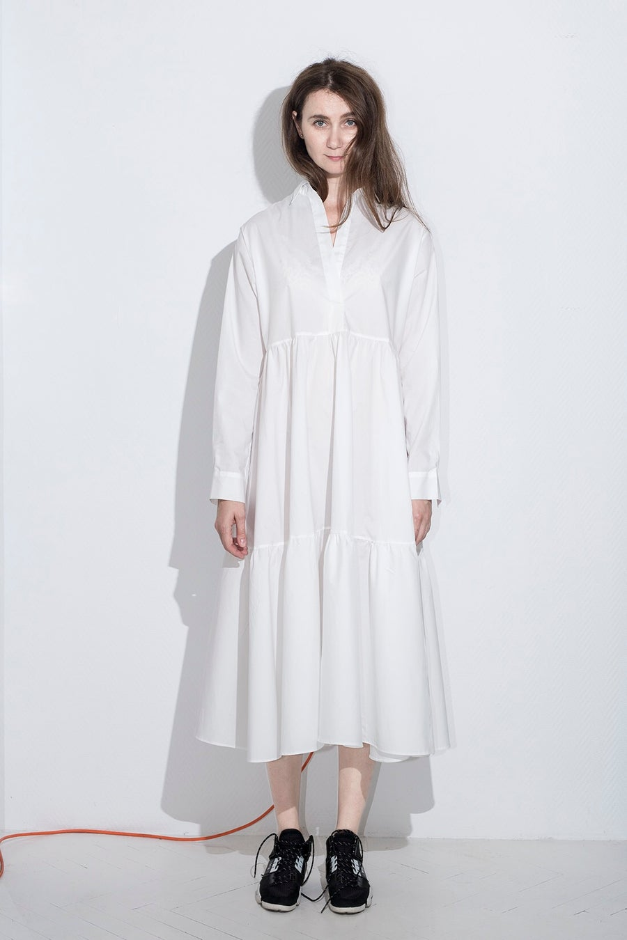 Image of White dress with wavy layers