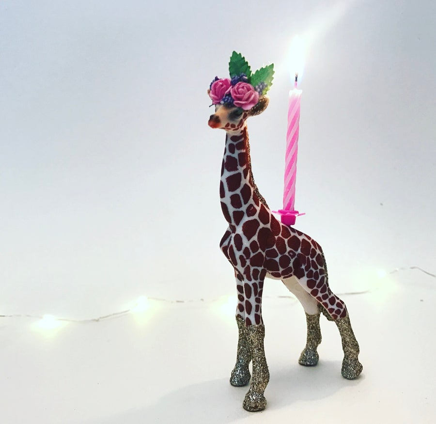 Image of GIRAFFE CALF with flower crown