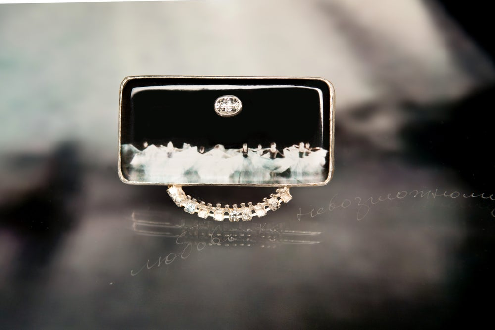 Image of sterling silver brooch with ballet photography under plexiglass