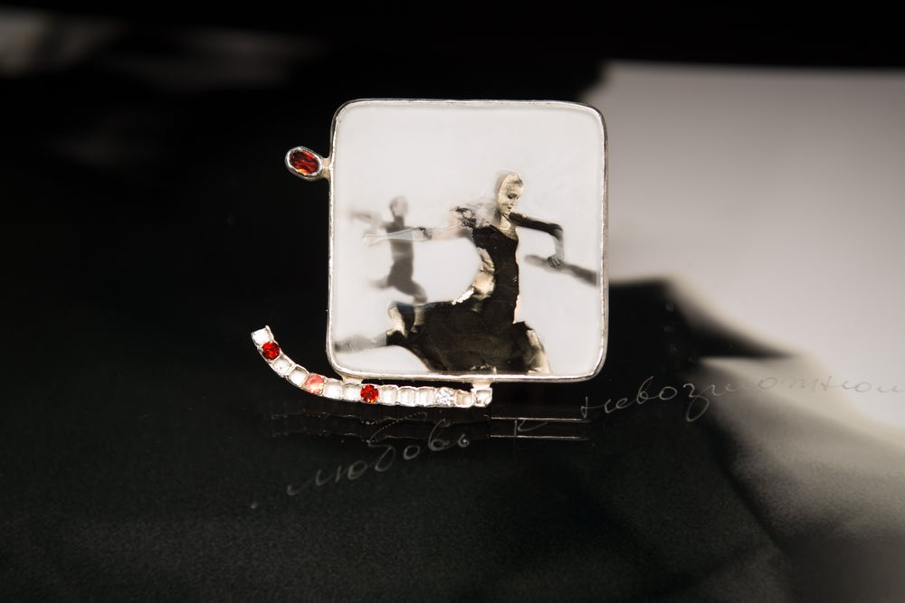 Image of sterling silver brooch with garnets, topaz and ballet photography under glass